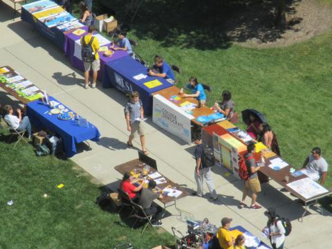 Student organization information tables out on the north campus diag.