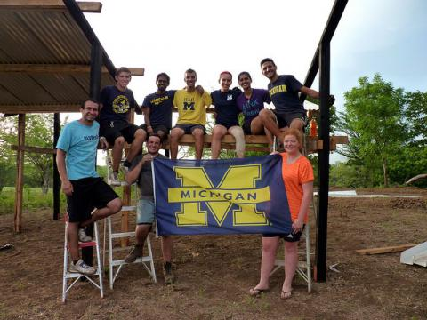 University of Michigan Flag and Students