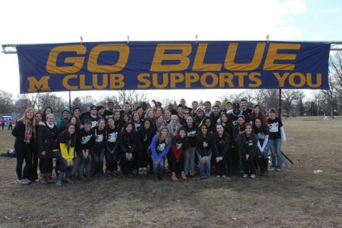 Go Blue banner with students underneth
