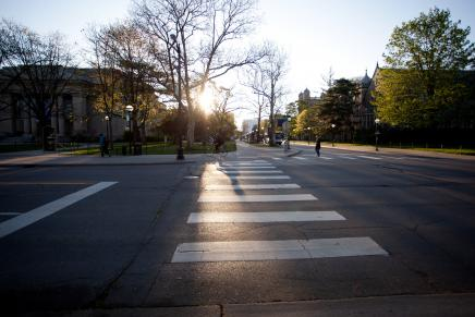 Picture of crosswalk with sun shining.