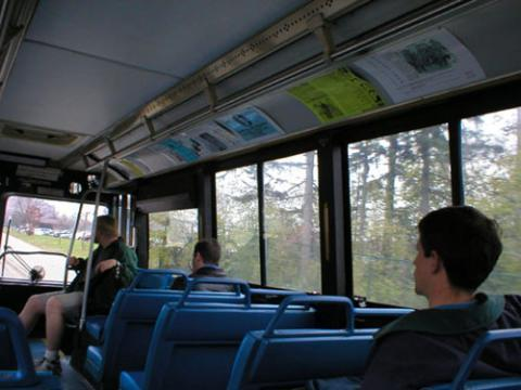 students are riding blue bus